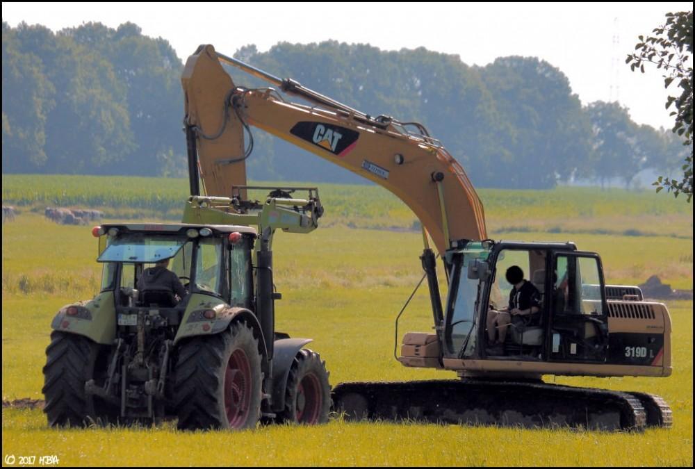 Caterpillar_319DL_Stapelmoor.thumb.jpg.8a06a46e944c3599a4b16ff0c0ab34c6.jpg
