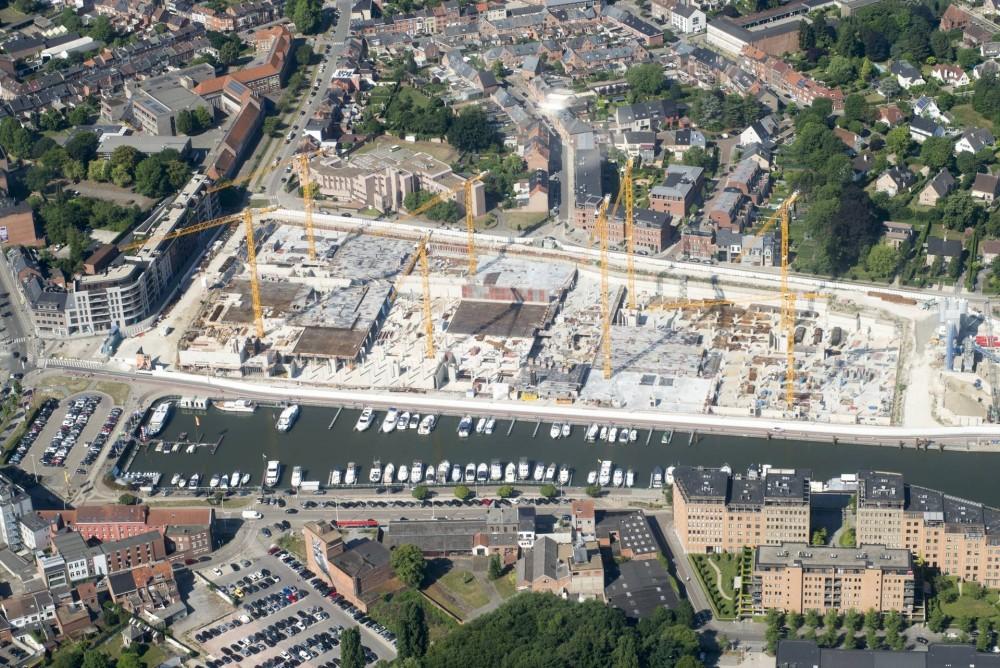 Mitten im Viertel: Das WOLFF-Rudel ragt zwischen den Fundamenten der Gebäude empor, die es innerhalb von 18 Monaten nach und nach aufbaut