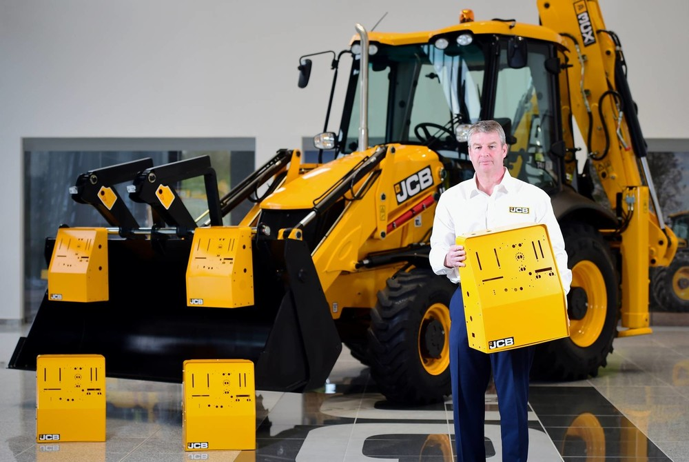 JCB Chief Innovation and Growth Officer Tim Burnhope pictured with the ventilator housing prototypes (1920).jpg